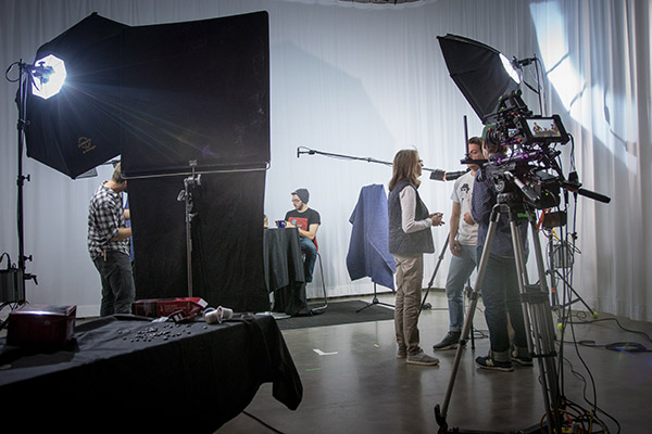 Students in the Department of Film and Media work on a film set at the Isabel Bader Centre for the Performing Arts.