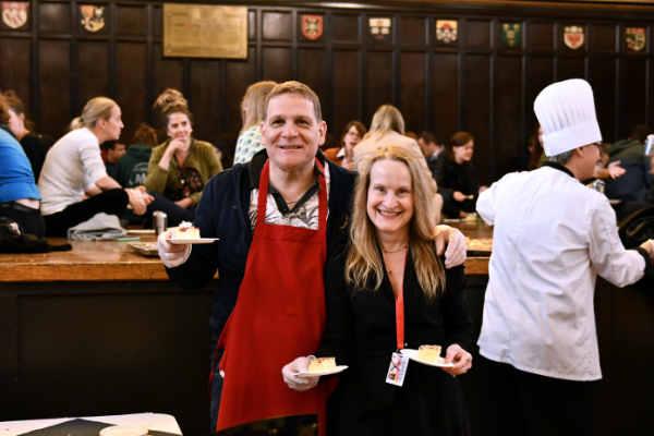 Principal and Vice-Chancellor Daniel Woolf and Julie Gordon Woolf handing out dessert at the annual faculty and staff appreciation event.