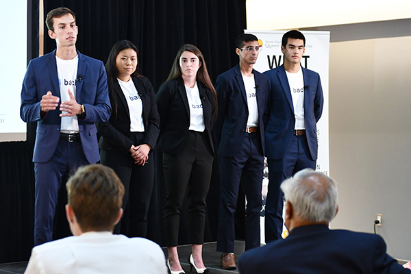 Backr, the team named by judges to take home the grand prize of $30,000, delivering their winning pitch.