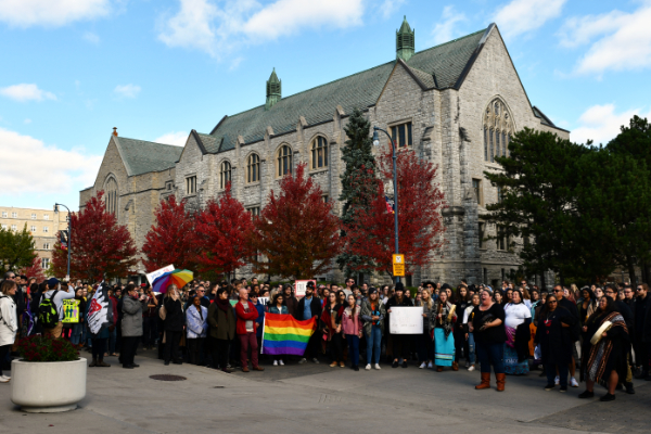 Students, faculty, and staff gather in solidarity with Queen's Indigenous and LGBTQ2+ communities.