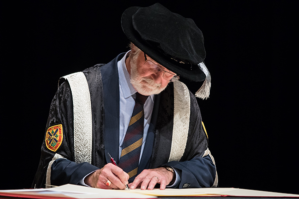 Principal and Vice-Chancellor Patrick Deane signs Magna Charta