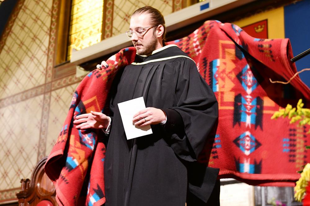 Michael Polak receives a blanket