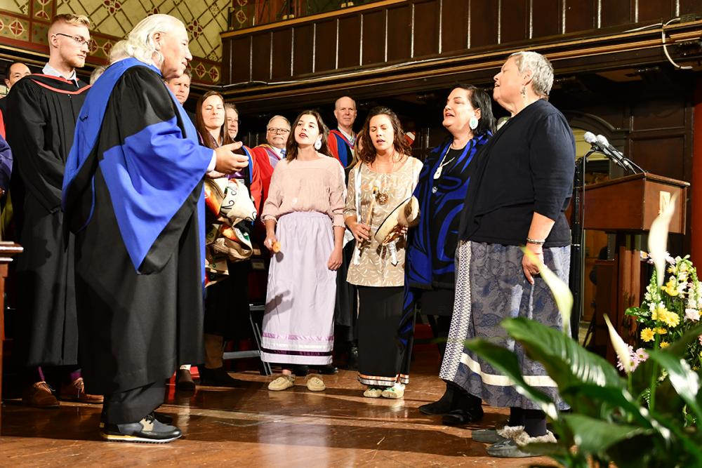 The Four Directions Women Singers perform an honour song for Senator Murray Sinclair as he receives an honorary degree from Queen's University on Friday afternoon.
