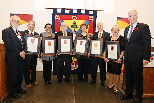 Distinguished Service Awards 2019 recipients and Prinicpal Deane and Chancellor Leech