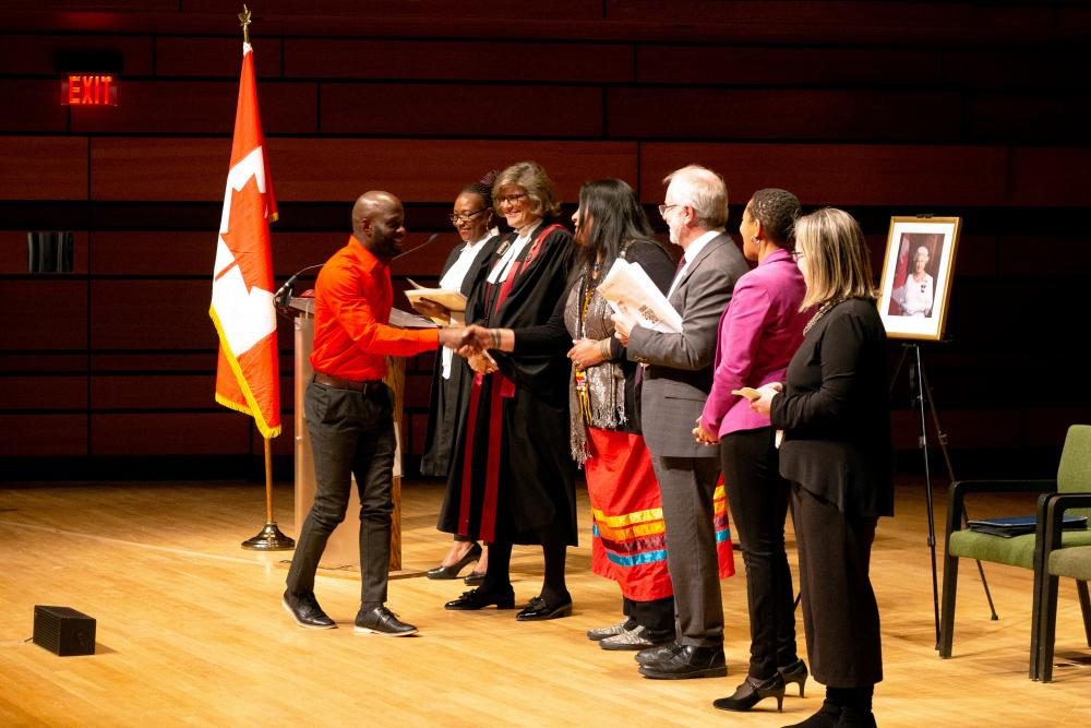 After taking their oath of citizenship, new Canadians were congratulated by Judge Marie Senécal-Tremblay, Queen's Elder-in-Residence Wendy Phillips, Principal Patrick Deane, Associate Vice-Principal Stephanie Simpson, and ICC Managing Director Amy Matchen.