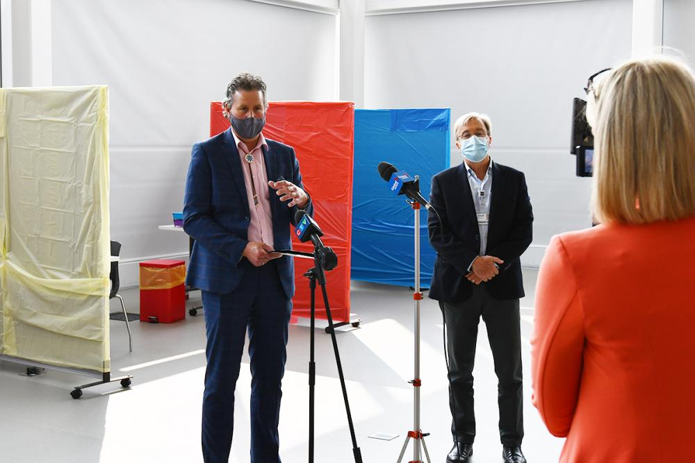 Provost and Vice-Principal (Academic) Mark Green and Dr. David Pichora, KHSC President and CEO, speak about the satellite COVID-19 testing site at Mitchell Hall. (University Communications)