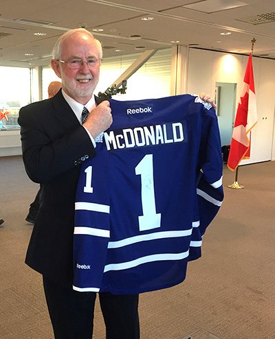 [Art McDonald with hockey jersey]