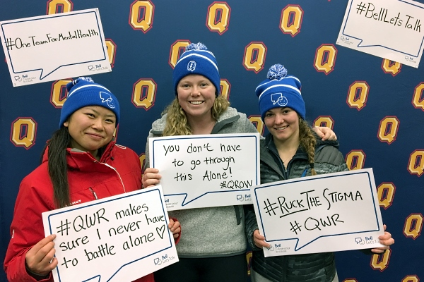 [Students with the Bell Let's Talk toques and signs]