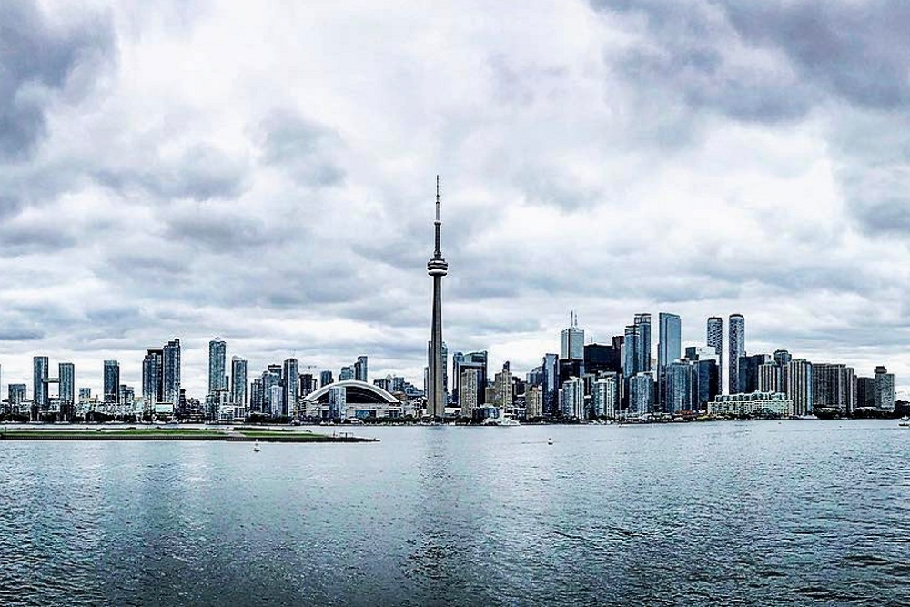 [Photo of Toronto skyline featuring the CN Tower]