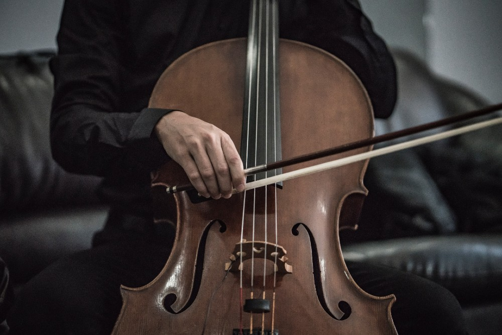 Photograph of a person playing the cello.