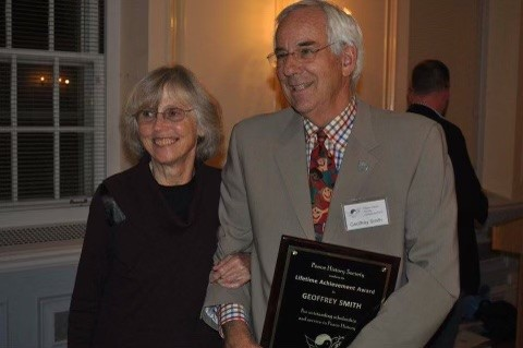 Image of Geoff smith accepting a Lifetime Achievement Award with his wife by his side