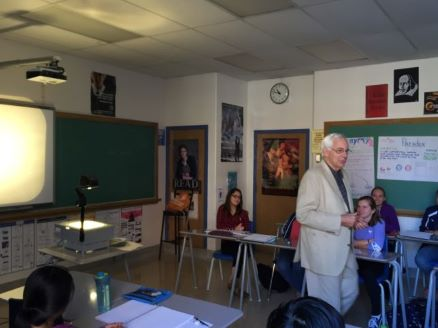 Image of Geoff Smith walking through a classroom at KCVI