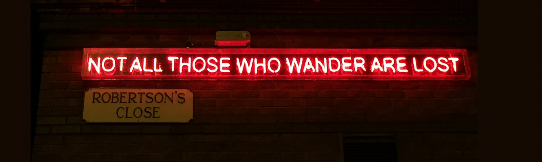 Image of a sign that reads: Not all those who wander are lost