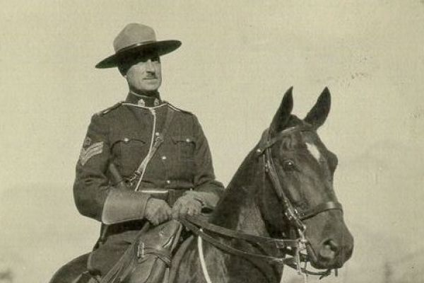 An image of a postcard of a Royal Canadian Mounted Police officer on horseback from 1935