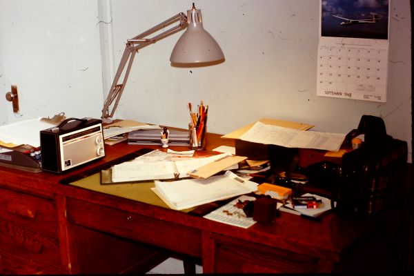 An image of a desk covered in various papers