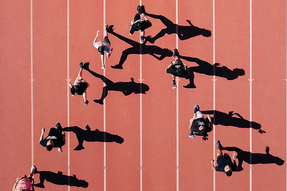 [overhead view of people running on a track]