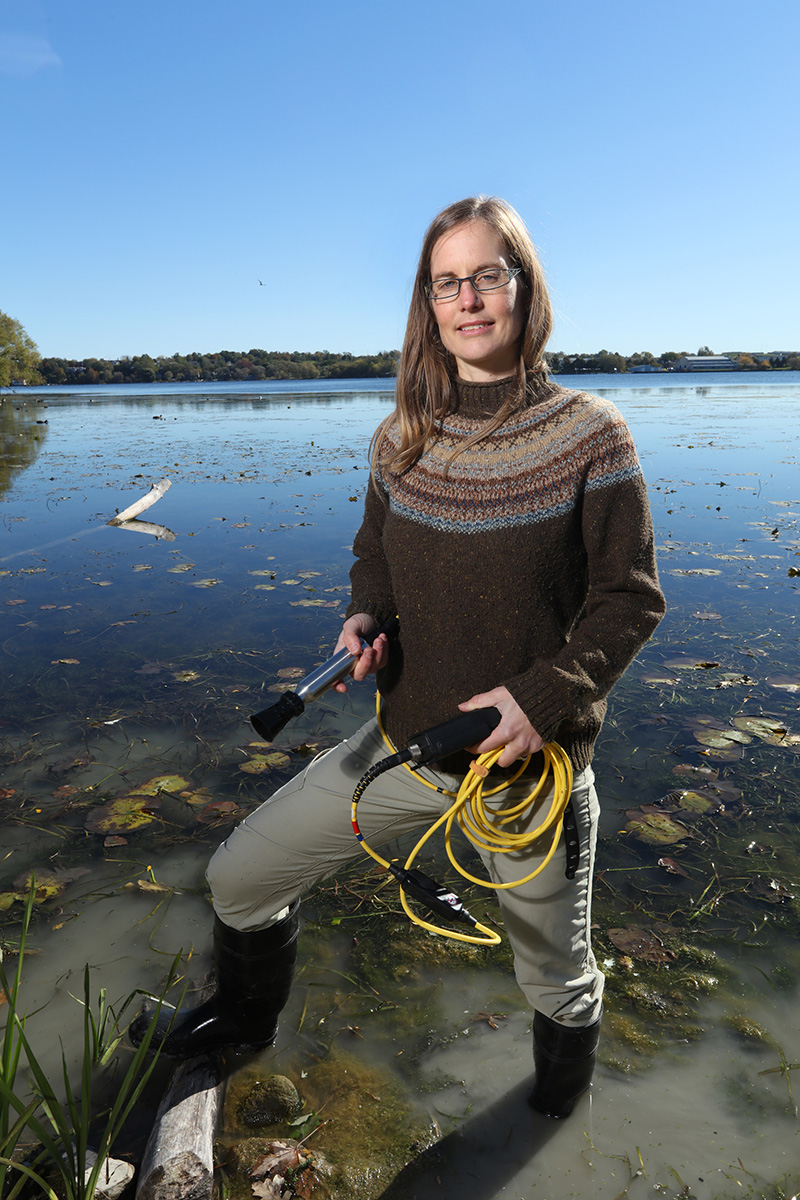 Orihel stands with research equipment in lake