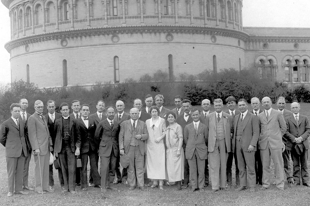 [historical image, researchers in front of observatory]