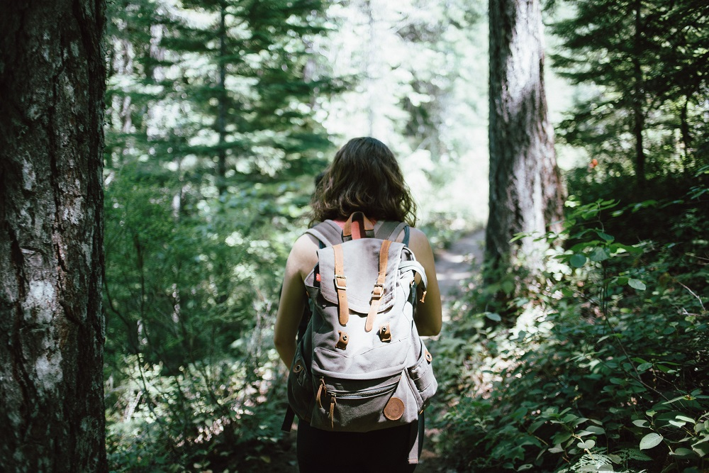 [Photo of a person hiking outside]