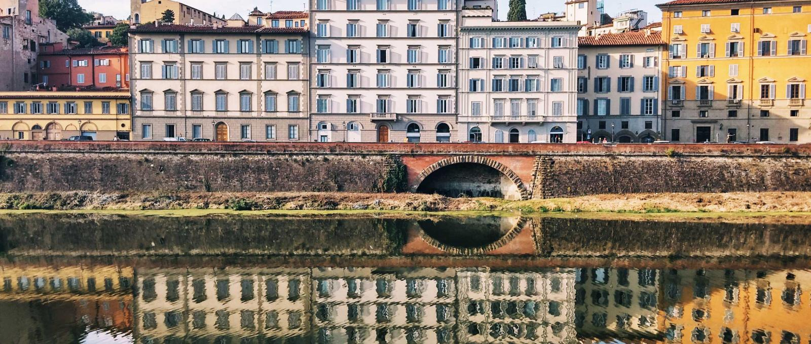 Landscape photo of buildings along a river in Florence, Italy