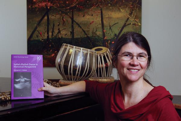 [ Professor Margaret Walker holding her book ]