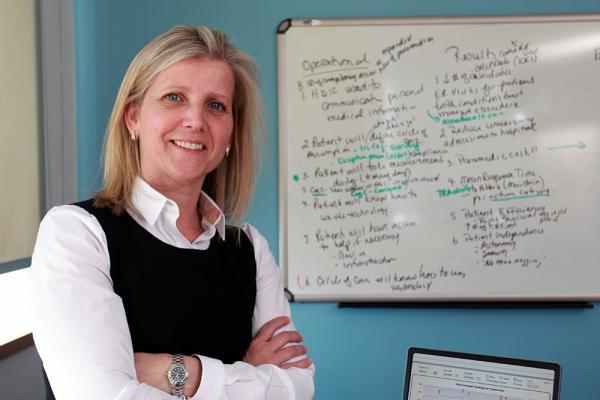 [ Kathryn Brohman in front of whiteboard ]