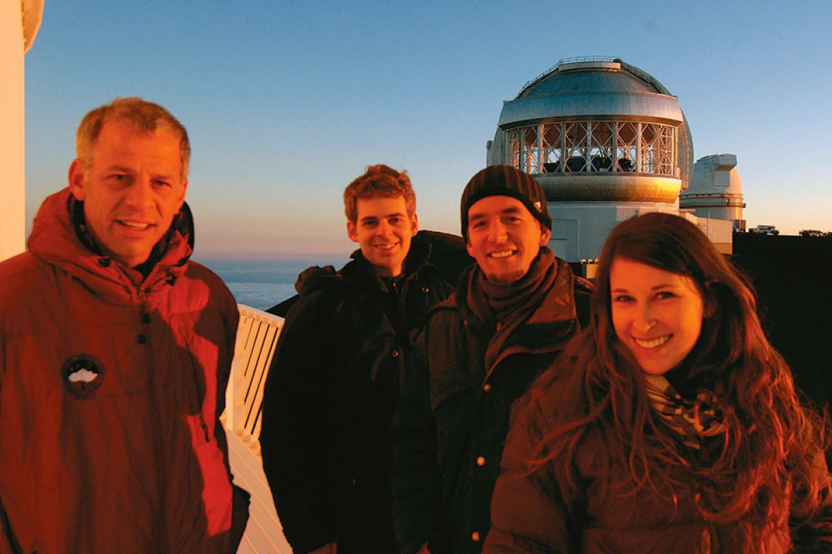 [COurteau and students at the Canada-France-Hawaii telescope]
