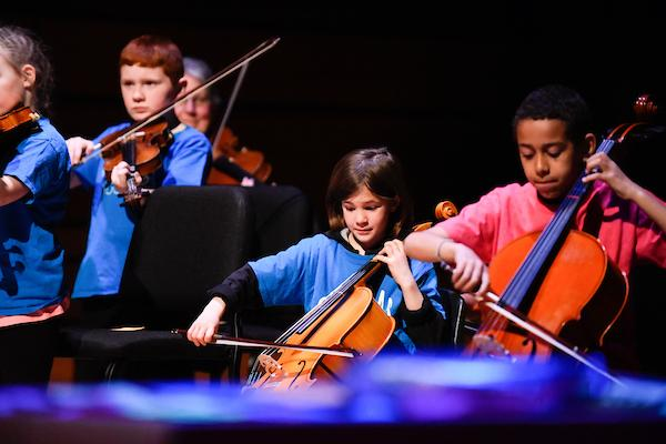 [Children with music training playing instruments]