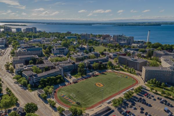 [Aerial photo of Queen's University campus]