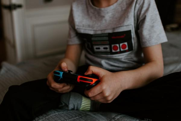 [Child playing video games]