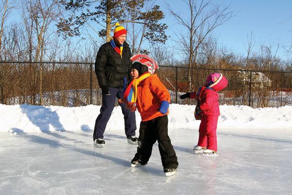 [ Ian Janssen skating with children ]