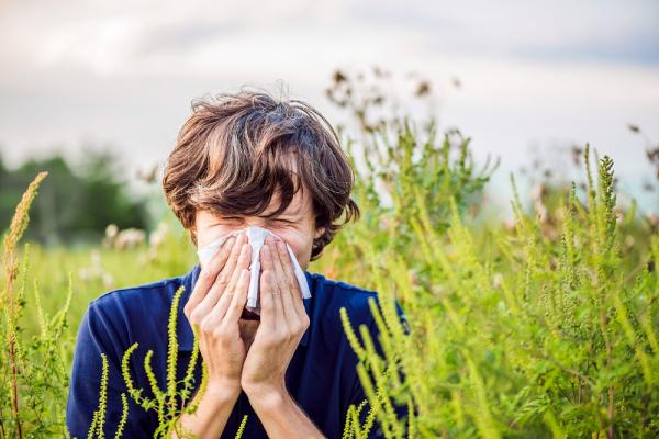 [Person sneezing outside]