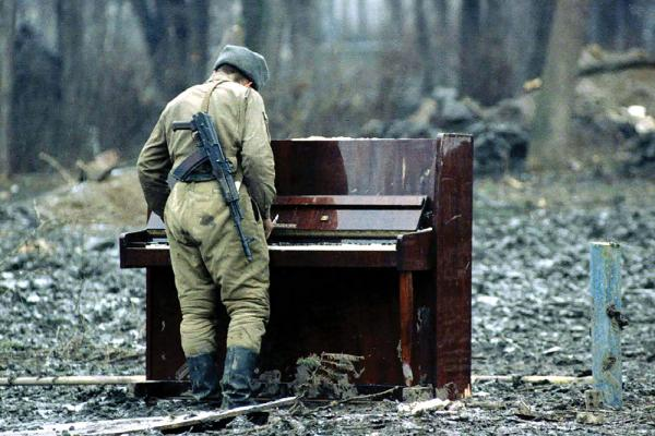 [soldier at a piano]