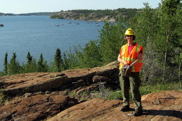 Dr. Heather Jamieson samples soil near the Giant Mine in Yellowknife]