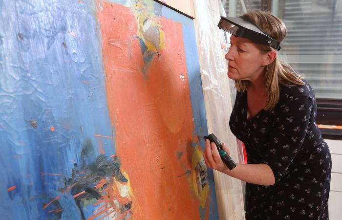 [Patrcia Smithen working on a painting]