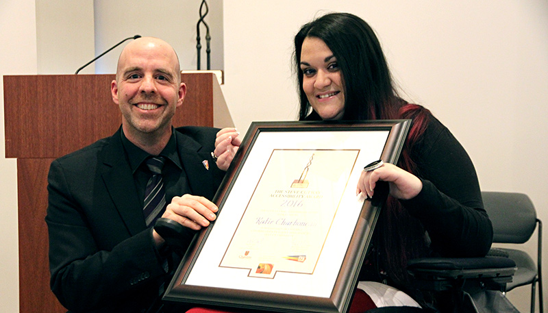 [Katie Charboneau accepting the Steve Cutway Accessibility Award from Provost Benoit-Antoine Bacon]