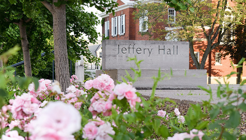 [roses in front of Jeffery Hall sign]
