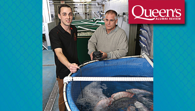 [Grad student Connor Elliott and Professor Bruce Tufts beside a tilapia tank]
