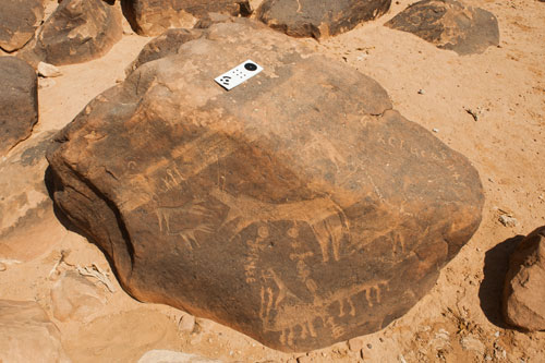 [Petroglyph and accompanying inscription that has been previously erased]