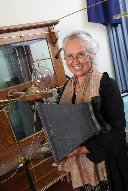 [Jacalyn Duffin holds a fluoroscope at the Museum of Health Care at Kingston]