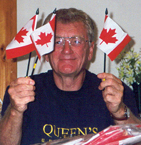 [Malcolm Peat with Canada flags]