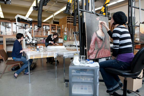 [photo of students in the Art Conservation Lab]