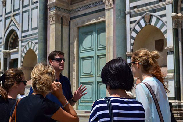 "[Instructor Darren Provost leads students through Florence, Italy, for the HIST 255 course, ""Renaissance and Reformation Europe""]"