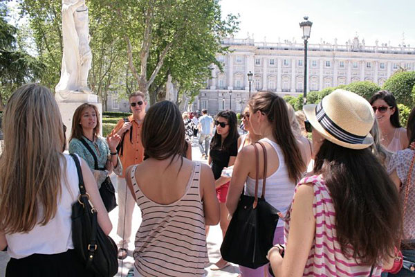 "David Parker (in the orange shirt) leading a group, with the help of a local tour guide in Madrid, Spain, for the HIST 396 course ""Topics in History: Spain and Spanish America 1492-1992"""