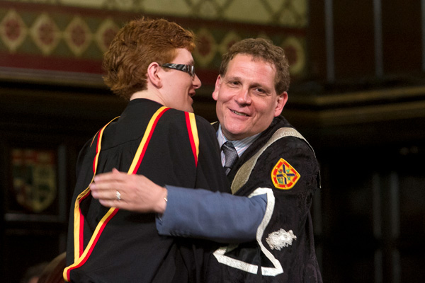 [Principal Woolf with his son Sam at Spring Convocation 2012]