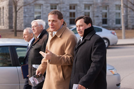 [Principal Daniel Woolf, Provost Alan Harrison and MPP for Kingston and the Islands John Gerretsen, show Brad Duguid, Minister of Training, Colleges & Univiersities around campus during his April 2nd visit.]