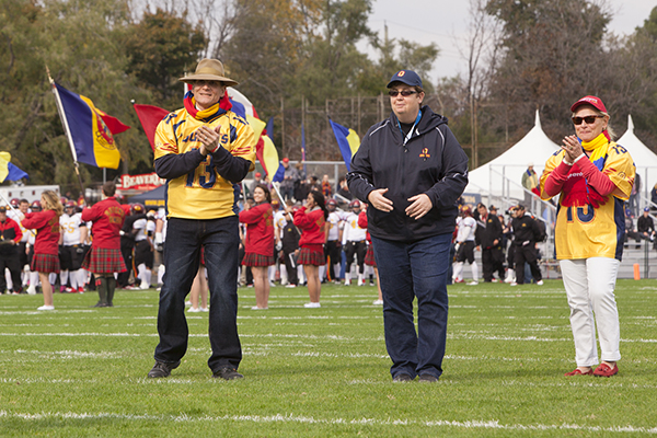 [Principal Woolf at the kick-off of the Homecoming Football Game 2013]