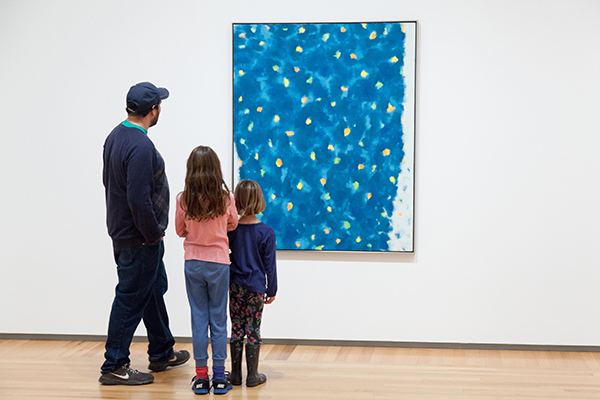 [Family viewing art]
