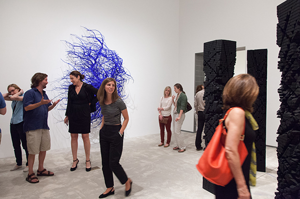 [Shayne Dark's sculpture and its admirers in the Contemporary Feature Gallery]