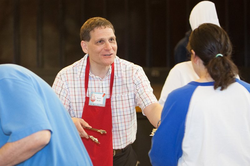 [Principal Daniel Woolf celebrated summer with staff and faculty at the Queen's Summer Barbecue in June 2014.]